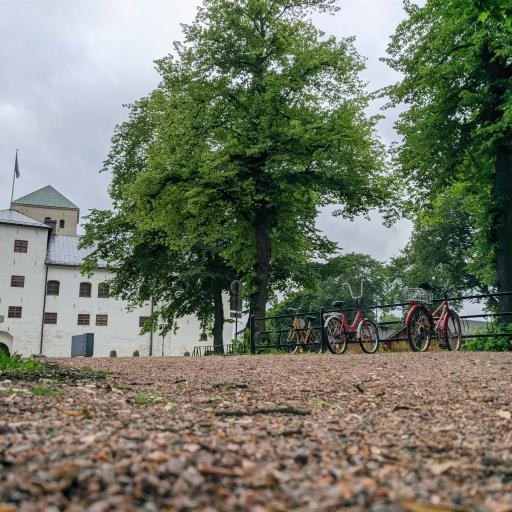 City park with Castle on the background and bikes on the foreground